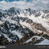 depositphotos_178403634-stock-photo-view-mountains-rocky-peaks-snow